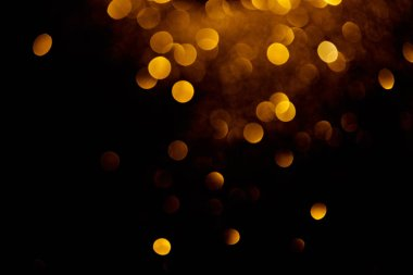 golden decorative bokeh on black background