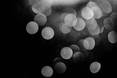 Glowing silver bokeh on black festive background stock vector