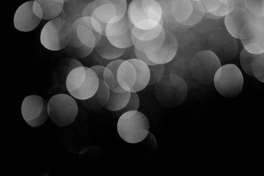 sparking silver festive bokeh on black background