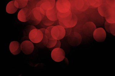 red festive bokeh on black background