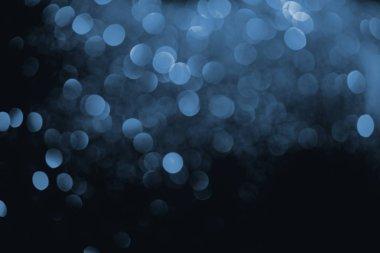 blue bokeh on dark background for celebration