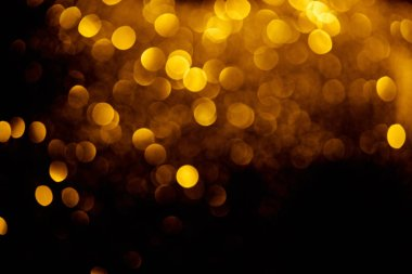 Abstract decorative background with blurred golden glitter stock vector