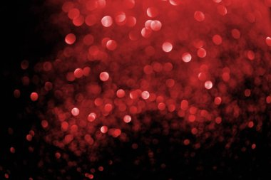 abstract background with blurred glowing red glitter