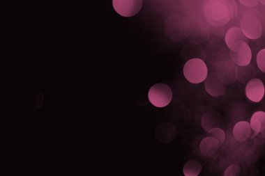 abstract dark background with beautiful purple bokeh and copy space
