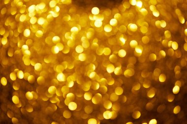 Abstract blurred gold glowing background stock vector
