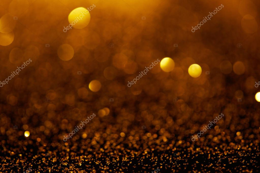 Abstract background with gold glitter and bokeh stock vector