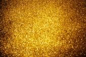absztrakt háttér, fényes arany csillámos díszítéssel