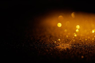 Blurred gold glitter on dark background stock vector