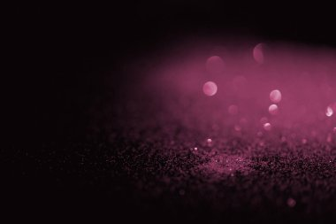 Blurred pink glitter on dark background stock vector