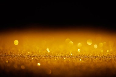 Sparking gold glitter with bokeh on black background stock vector