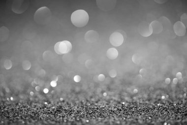 abstract silver glitter with shiny bokeh on background