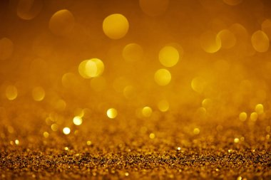 Abstract golden glitter with bokeh on background stock vector