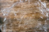 Fotografie top view of rustic wooden table covered with flour