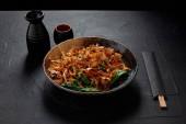 delicious japanese meal with katsuobushi, dried bonito shavings, chopsticks and sake
