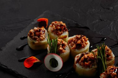 close-up view of delicious sushi roll with creamy eel and kimchi mayonnaise