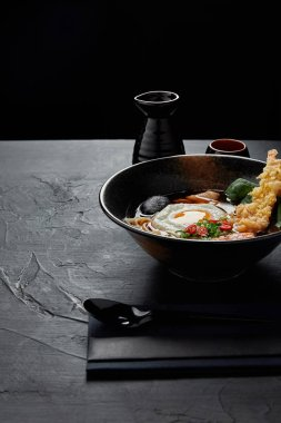 delicious traditional japanese soup in bowl with chopsticks and spoon