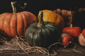 pumpkins on wooden table with hay, halloween concept