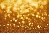Photo golden bokeh christmas background with glittering sequins