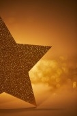 Photo half of golden shiny star for christmas decoration