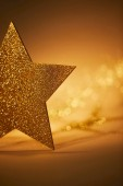 Fotografie golden glittering star for christmas decoration