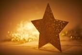 Zlatý přívěsek hvězda pro vánoční dekorace