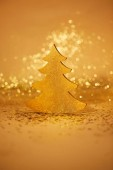 Photo golden shiny christmas tree for decoration with glitter