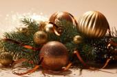 Fényképek close up of glittering christmas toys on pine branch on tabletop