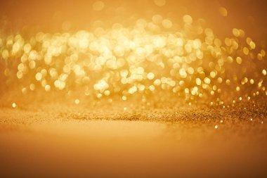 Bokeh christmas background with golden glitter stock vector