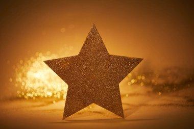 Golden glittering star for christmas decoration on tabletop stock vector