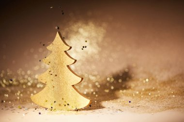 golden glittering christmas tree for decoration with falling sequins