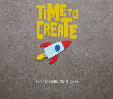 colorful handmade rocket on gray background with