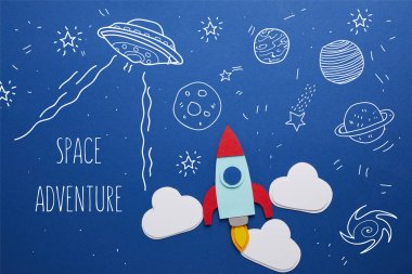 Clouds and rocket on blue background with universe icons and