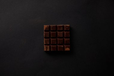 top view of gourmet sweet chocolate on black background