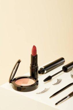 Close-up shot of makeup supplies kit on beige stock vector