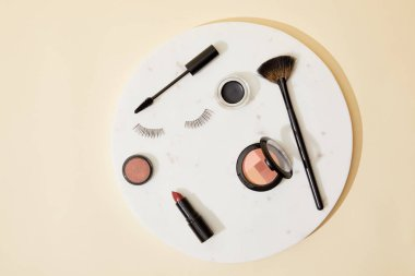 Top view of various cosmetics lying on round plate stock vector