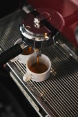 close-up view of coffee maker and two mugs with espresso