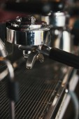close-up view of professional coffee maker in coffeehouse
