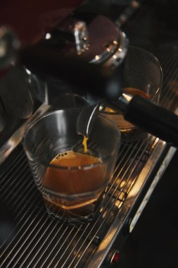Close-up of coffee machine preparing espresso in two cups stock vector