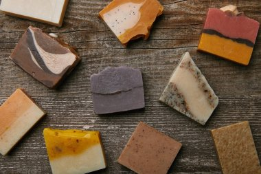 top view of handmade soap pieces on rustic wooden surface