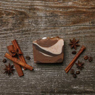 top view of handmade soap with spices on rustic wooden tabletop