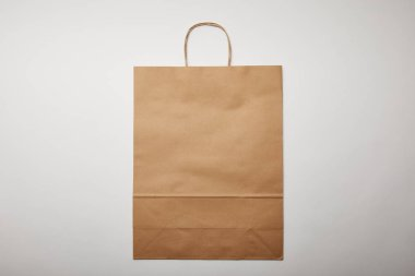 Top view of food delivery paper bag on white surface, minimalistic concept stock vector