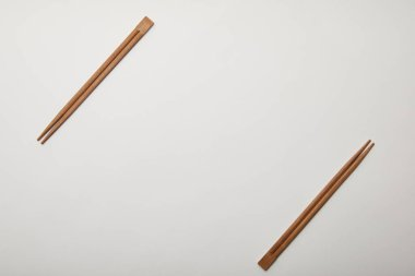 flat lay with arranged chopsticks on white surface, minimalistic concept