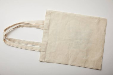 top view of cotton bag on white surface, minimalistic concept