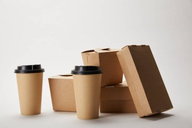 Disposable coffee cups and cardboard food boxes on white stock vector