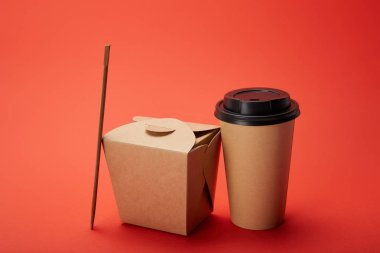 Noodle box, paper cup of coffee with chopsticks on red, minimalistic concept stock vector