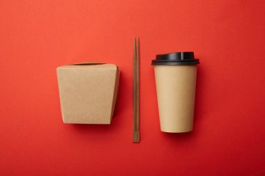 Flat lay with chopsticks, noodle box and disposable cup of coffee on red surface, minimalistic concept stock vector