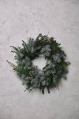 Fotografie fir wreath for Christmas decoration hanging on grey wall in room