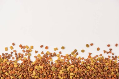 view from above of pile of dog food on white surface