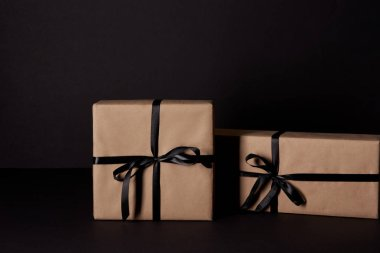 wrapped gift boxes on black surface, black friday concept