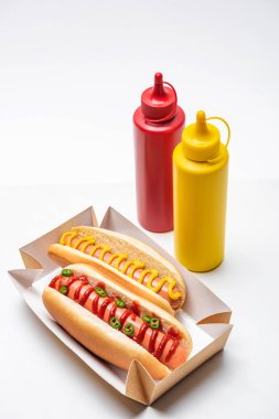 Close-up shot of tasty hot dogs with mustard and ketchup on white stock vector